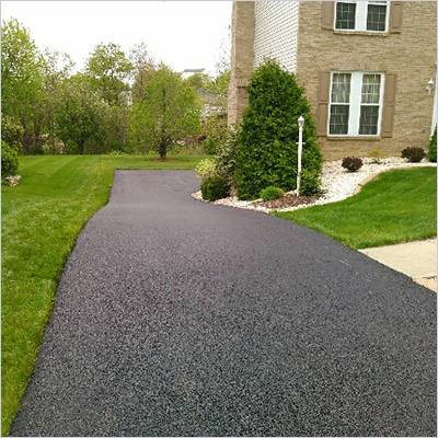 Tony Broadway Paving residential driveway off two story home.
